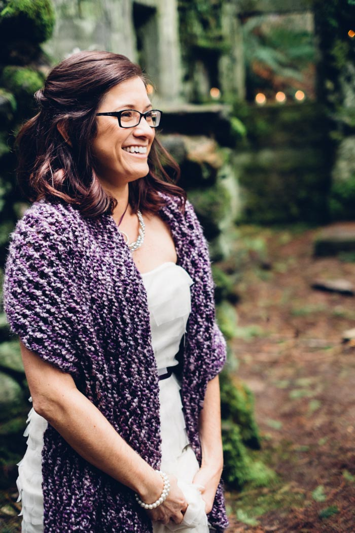 bride wearing purple knit shawl