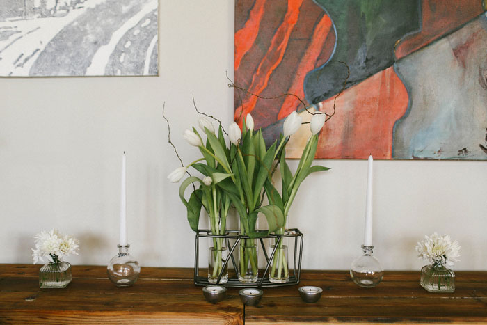 white tulips on sideboard