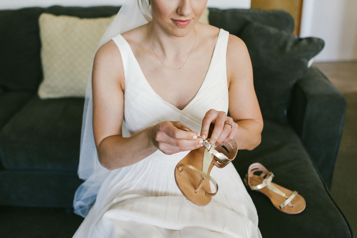 bride putting other shoes