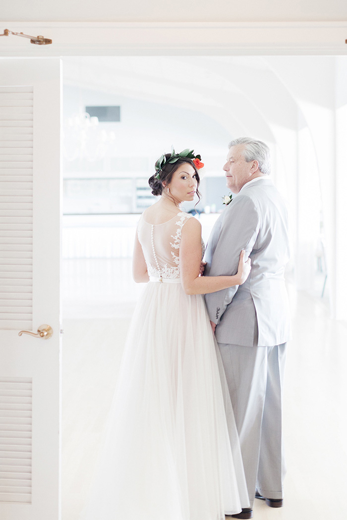 bride waiting with father