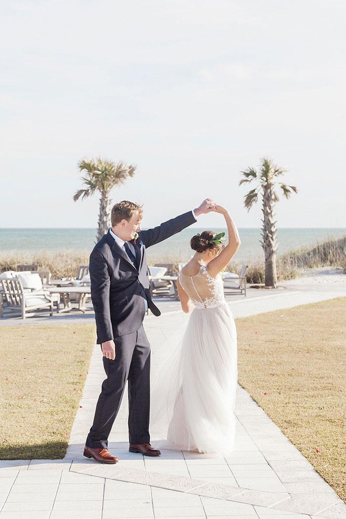 bride and groom dancing on boardwalk