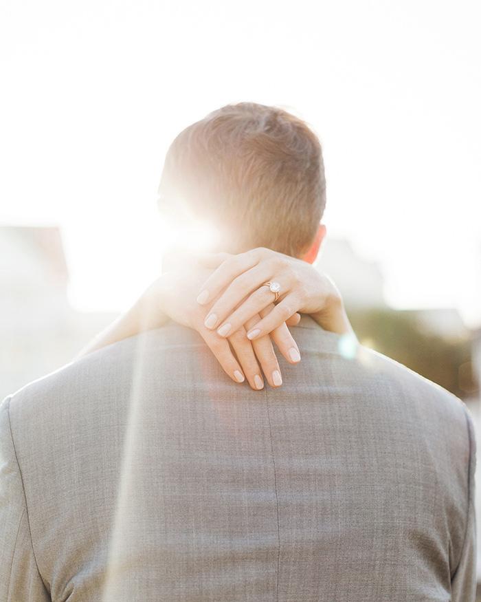bride's arms around groom's neck