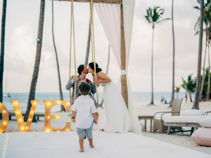 kid photo bombing wedding portrait