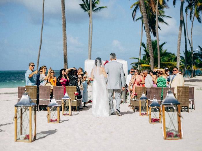 bride walking down aisle on the beach