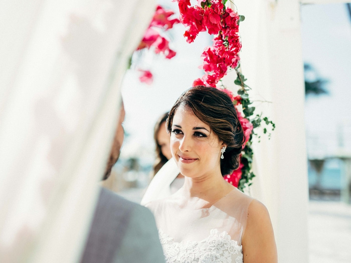 bride looking at groom during ceremony