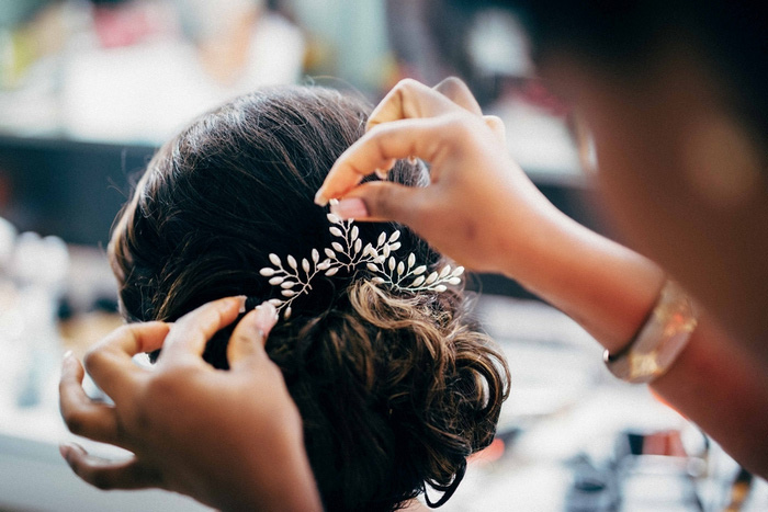 jeweled comb being placed in bride's hair