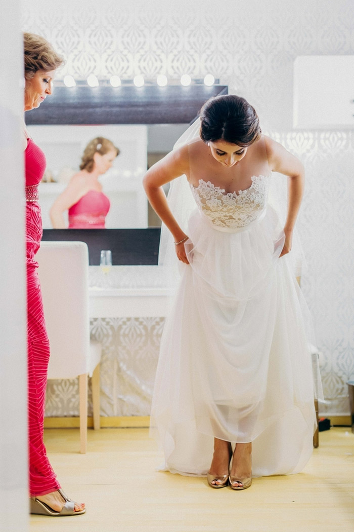 bride lifting dress to reveal shoes