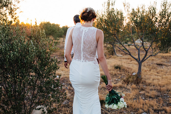 bride walking in olive grove