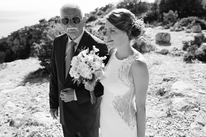 bride waiting to walk down aisle with father