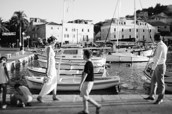 bride and groom walking towards each other on dock