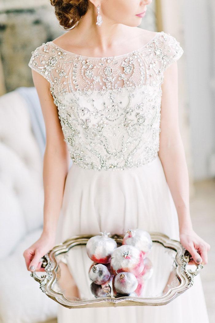 bride holding tray of pomegranates