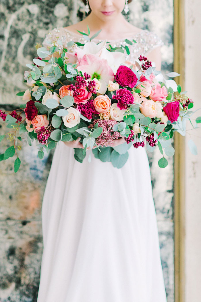bride holding large bouquet of flowers