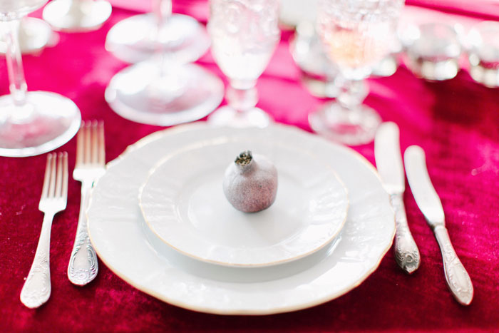 silver pomegranate on plate