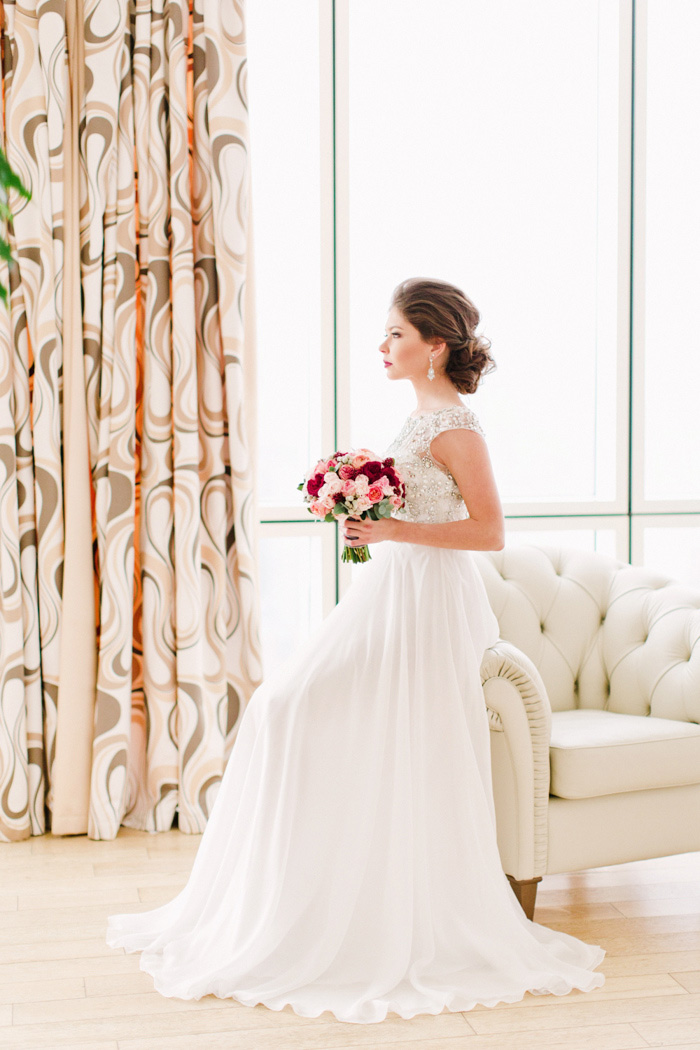 portrait of bride sitting on chair arm