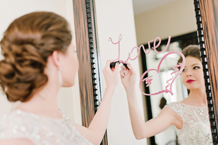 bride writing on mirror