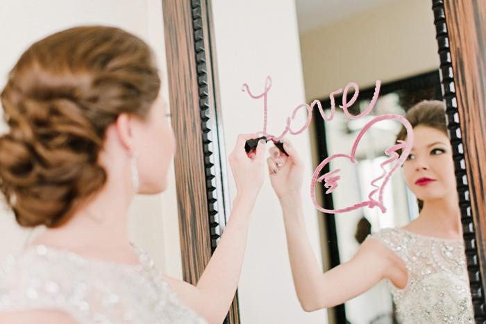 bride writing on mirror