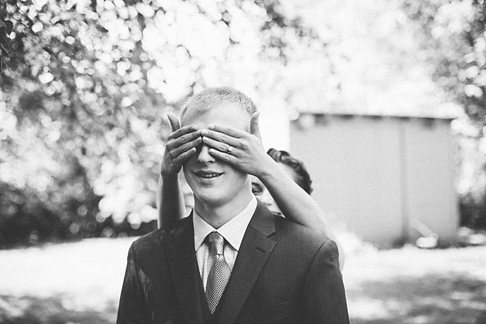 bride covering groom's eye