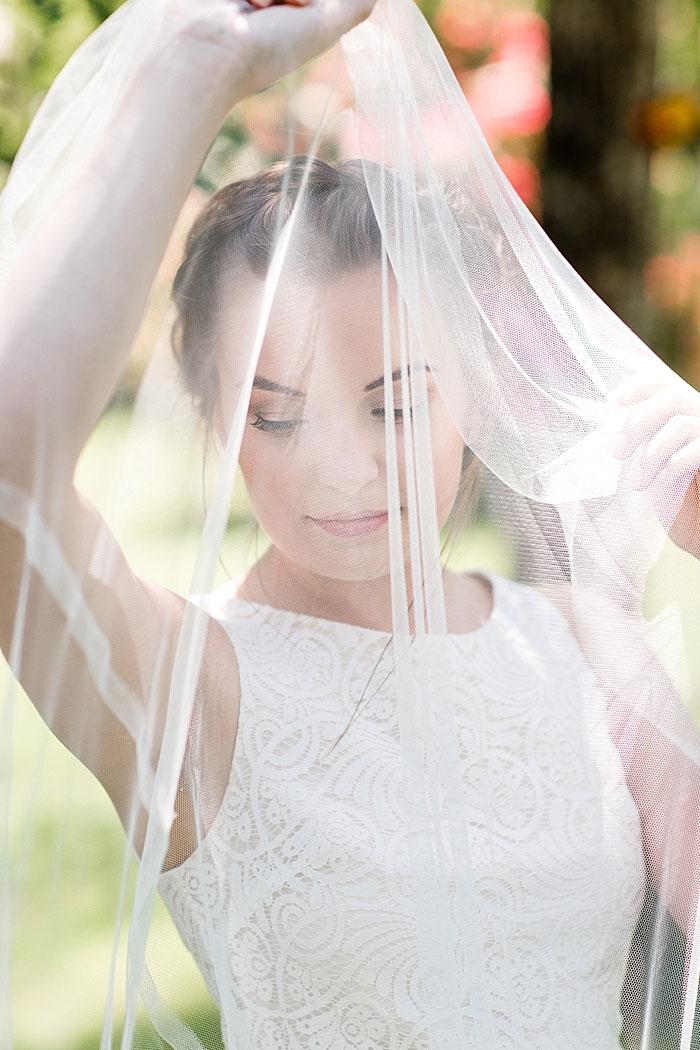 bride holding up veil