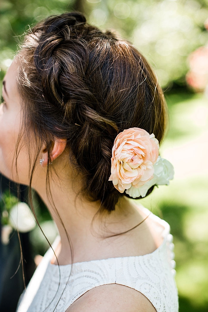 peach rose in bride's hair