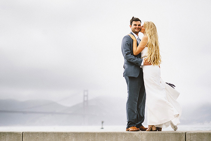 bride and groom portrait with golden gate bridge in background