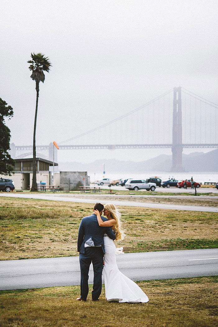 bride and groom portrait by golden gate bridge