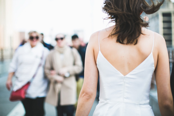 back of bride walking on street