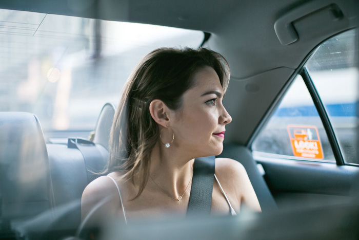 bride portrait in taxi