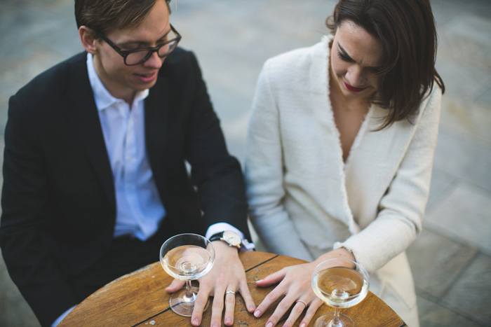 bride and groom comparing their rings
