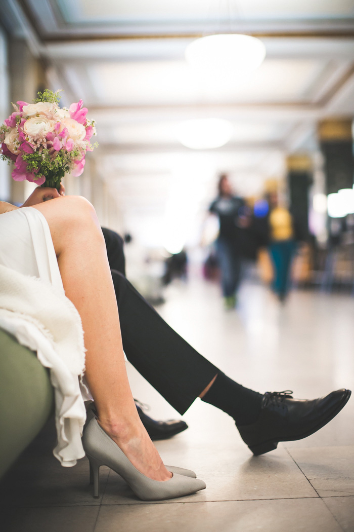 bride and groom's legs while waiting at city hall