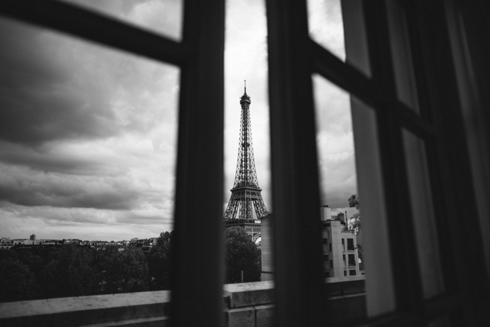 view of eiffel tower through window