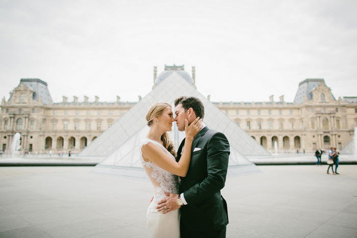 bride and groom portrait in front of Louvre