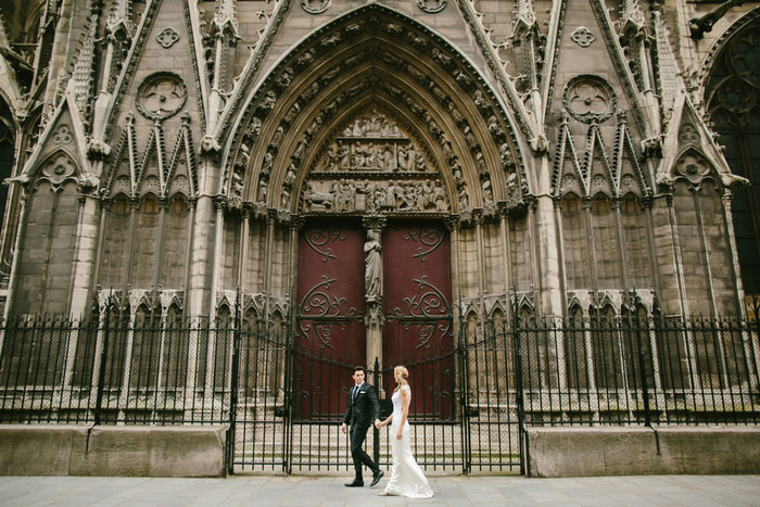 bride and groom portrait in front of Notre Dame