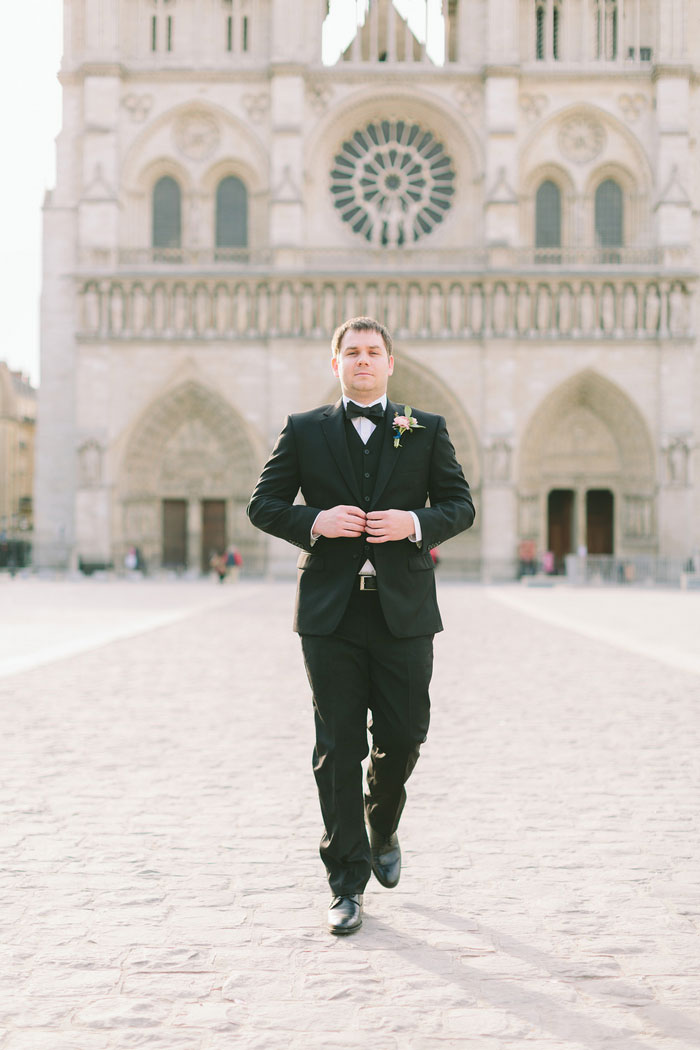 groom portrait in front of Notre Dame Cathedral