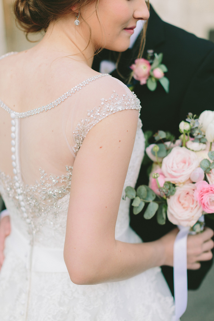 detail of back of bride's dress