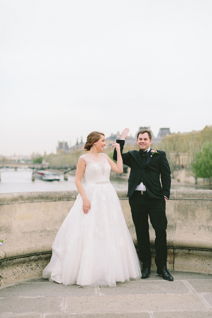 bride and groom tossing key into the seine