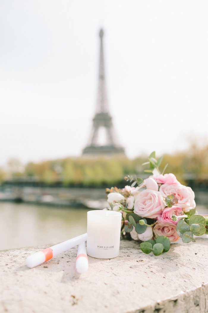 candles and bouquet with eiffel tower in the background