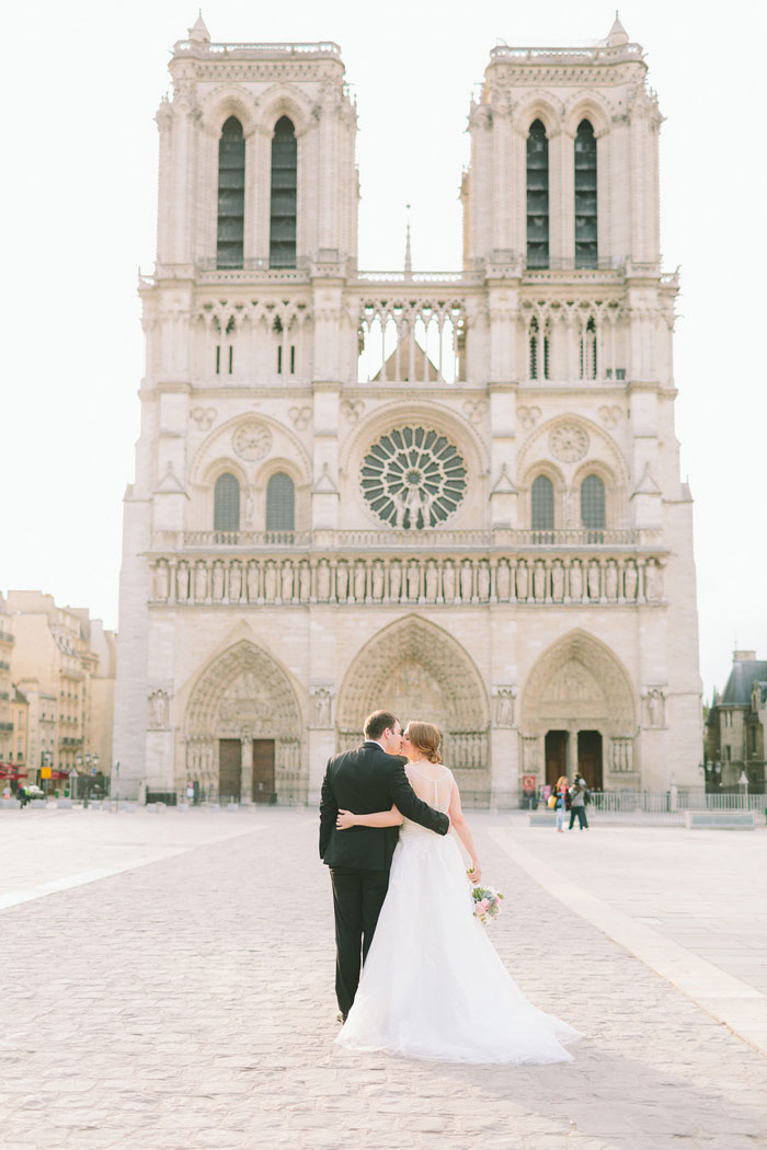 bride and groom portrait in front of Notre Dame Cathedral