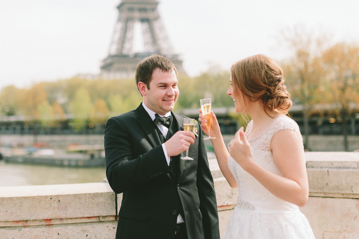 bride and groom toasting each other with champagne