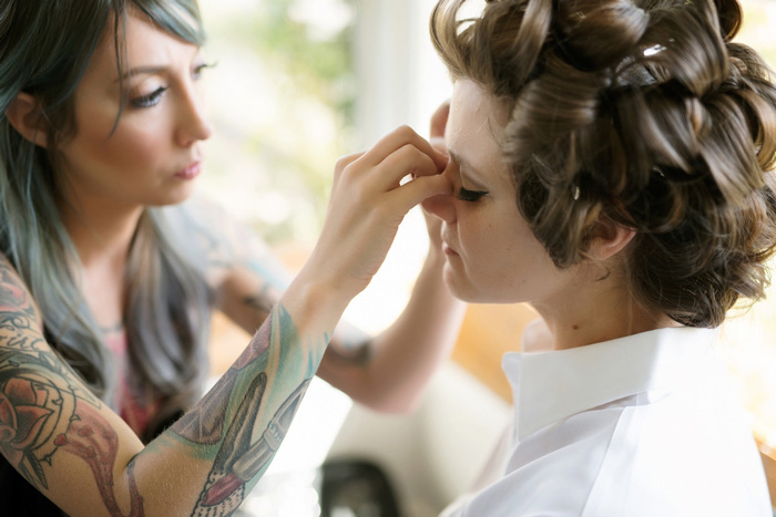 bride having fake eyelashes applied
