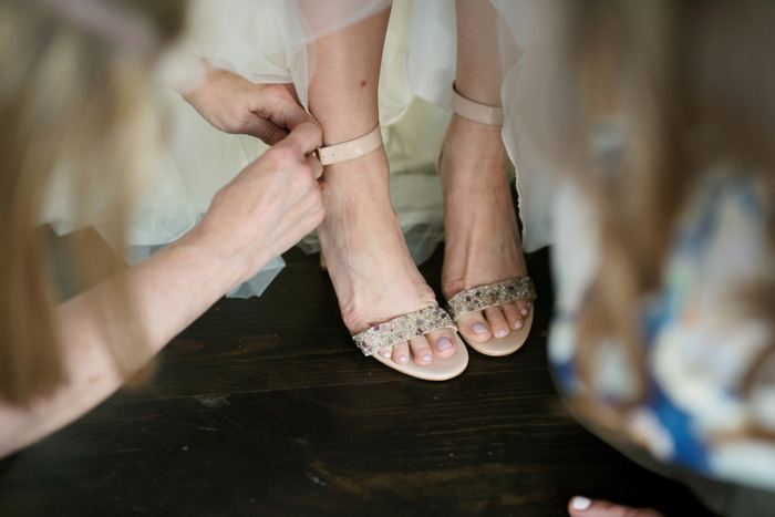 bride's shoes being buckled