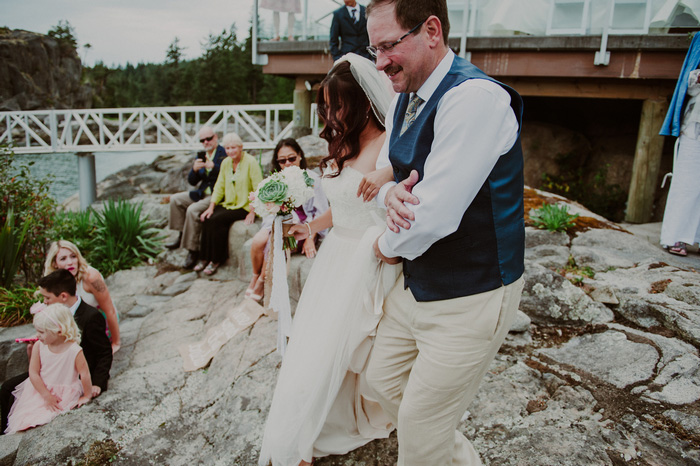 bridewalking down aisle with father
