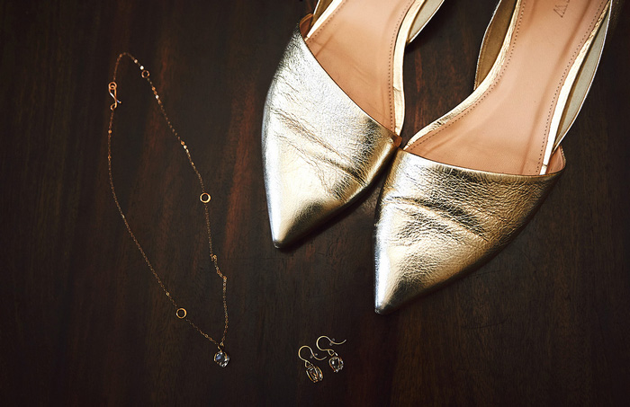 bride's gold shoes and accessories