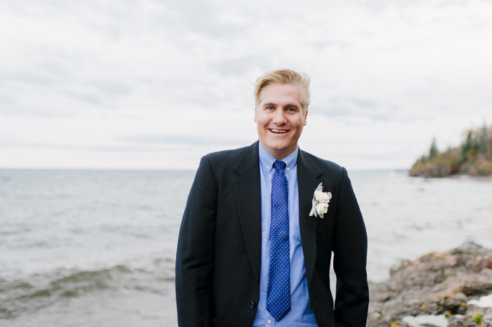 groom portrait by the lake