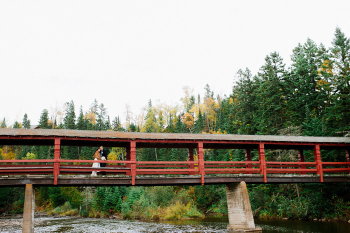 bride and groom portrait on covered bridge