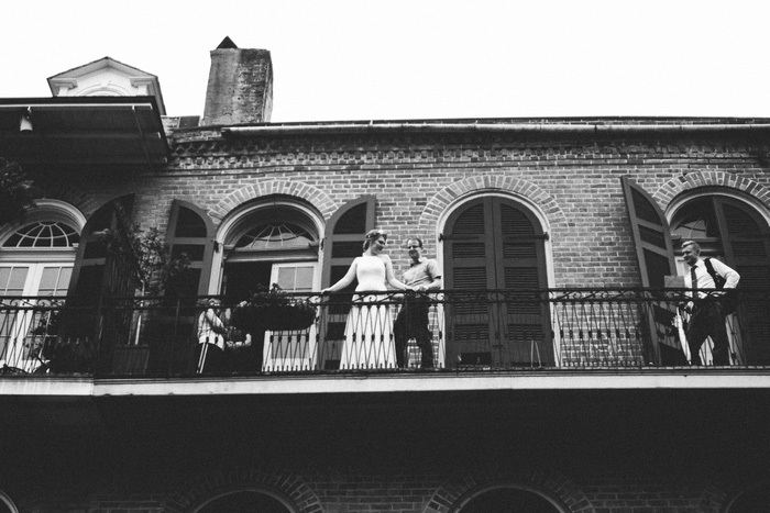 bride and groom on New Orleans balcony