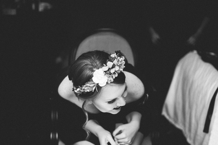 bride laughing in make-up chair