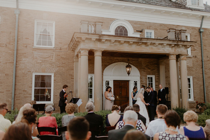 wedding ceremony on estate front lawn