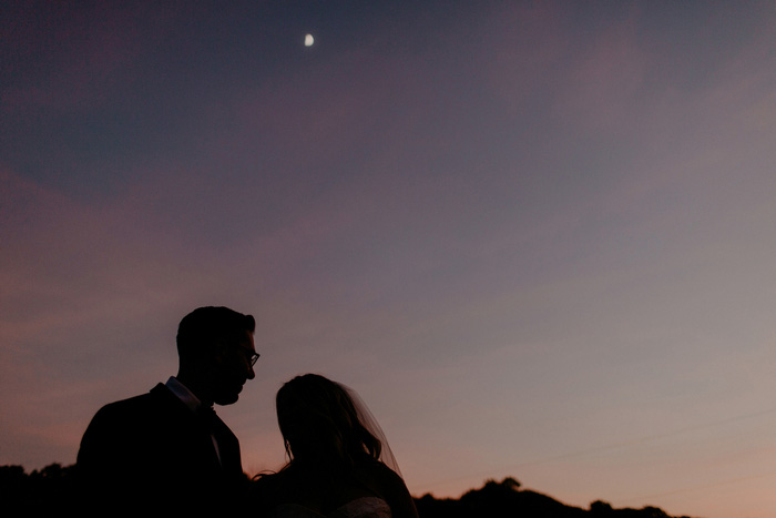 bride and groom silhouette at night