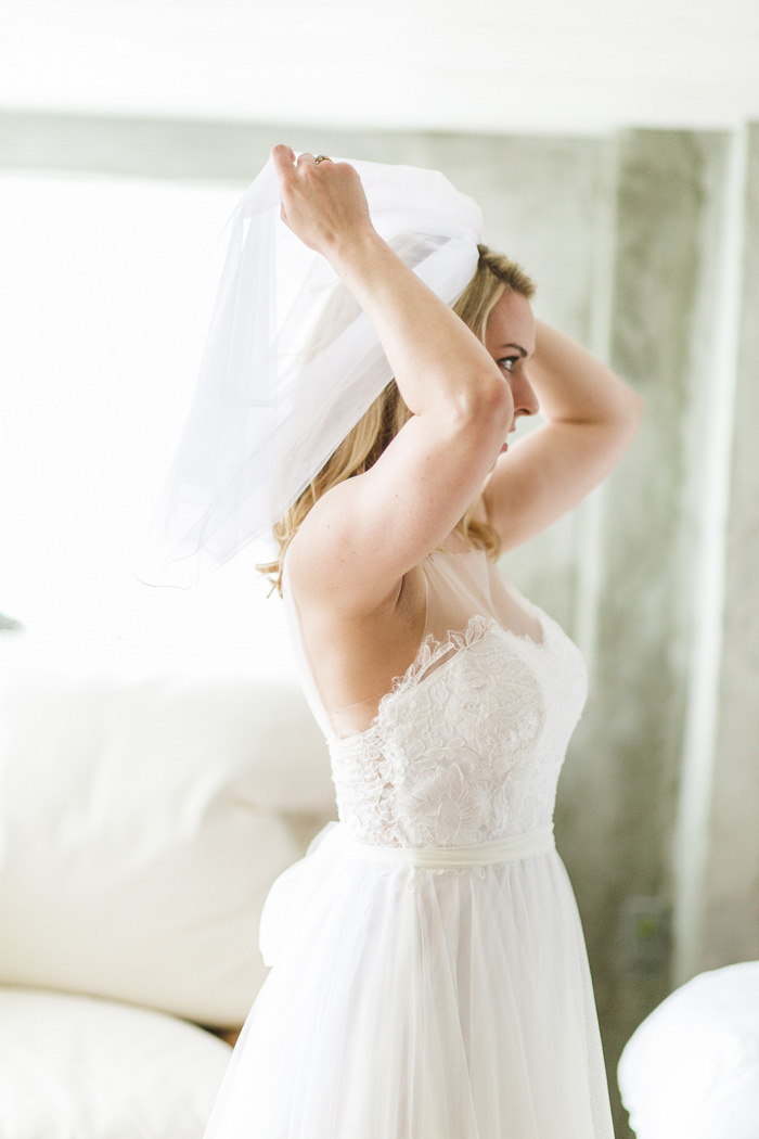 bride adjusting veil