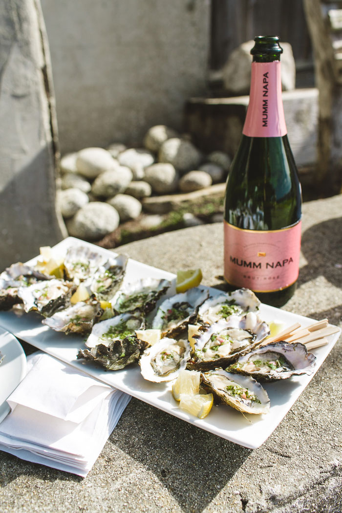 plate of oysters and bottle of champagne